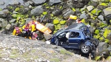 Man survives falling 100 feet down a cliff in his car