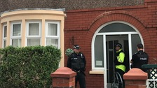 Police outside a property raided by counter terrorism officers on Manor Street, Accrington
