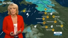 Emma Jesson in red jacket in front of Sunday night Monday morning weather graphics for the north west