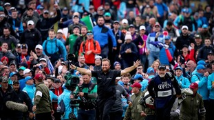 Shane Lowry and caddie Bo Martin celebrate victory at the 148th Open