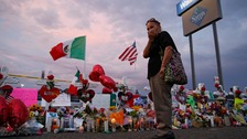 A woman stands at a memorial for the victims of the mass shooting in El Paso, Texas.
