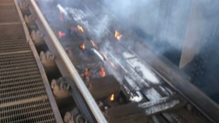 The fire on the tracks between Victoria and Clapham Junction which has caused several delays.