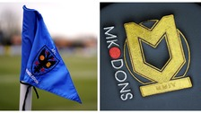 AFC Wimbledon's badge and MK Dons' badge.