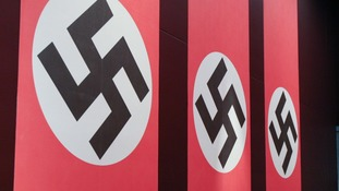 Man arrested after swastika flag displayed in Neath