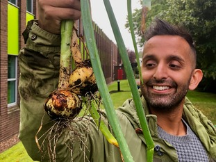 Dr Amir Khan with his unearthed onions