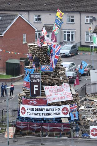 Banners are attached to a bonfire in the Bogside area of Londonderry