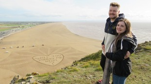 Stefan Cahill proposed to Heidi Mason with this message in the sand at Brean beach.