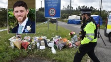 Grieving officers lay tributes for killed colleague