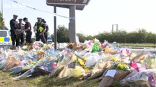 Roadside covered in flowers after PC Harper's death