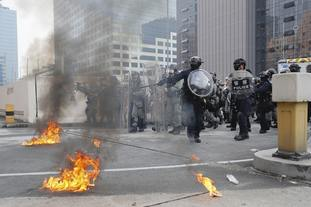 Petrol bombs were hurled at riot police