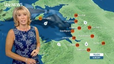 Emma in blue flowery dress in front of Sunday weather graphic