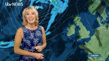 Emma Jesson in blue dress in front of Sunday weather graphics