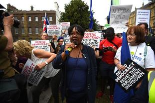 Diane Abbott addresses protesters outside the Houses of Parliament