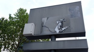 Banksy rat with knife mural