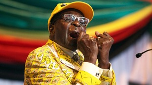 Robert Mugabe clenches his fists as he delivers his speech at his party's 13th annual conference in 2012.