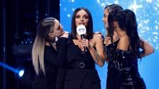 Jesy Nelson on stage with her Little Mix band mates.