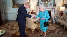 Queen Elizabeth II welcomes newly elected leader of the Conservative party Boris Johnson in July.