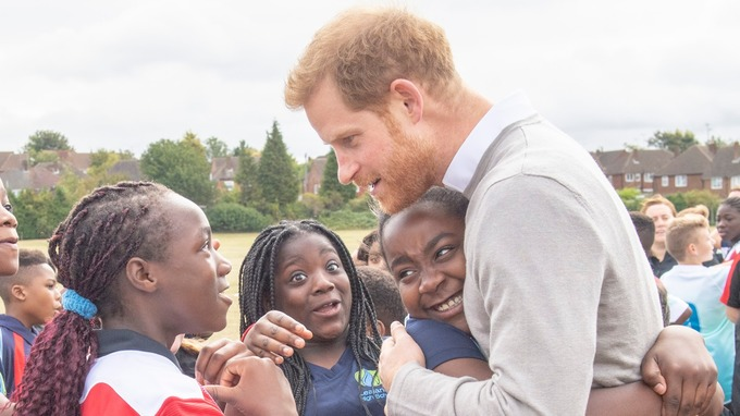 A hug for Prince Harry in Luton to boost playing rugby in