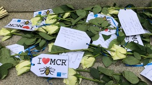 Floral tributes left in St Ann's Square in Manchester city centre.