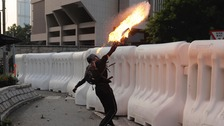 A protester throws a petrol bomb outside Hong Kong government offices.
