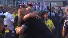Gareth Thomas hugs husband after finishing Ironman Wales
