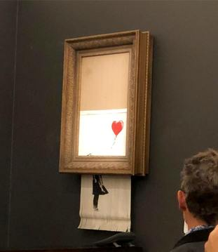 Banksy's artwork, Girl With Balloon which shredded itself