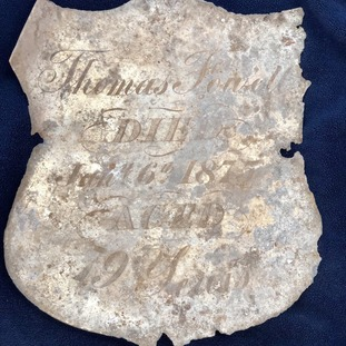 A name plate that says 'Thomas Forvell, died Jan 6th 1877'