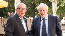 Prime Minister Boris Johnson is greeted by European Commission President Jean-Claude Juncker