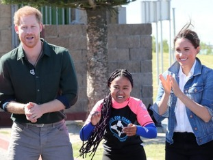 The Duke and Duchess of Sussex with surf mentors during a visit to Waves for Change at Monwabisi Beach in Cape Town.