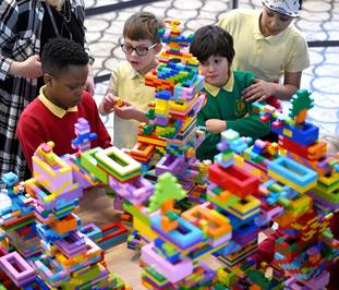 Pupils from the Globe Primary School build a Lego sculpture