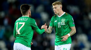 Ireland's James McClean with Aaron Connolly after the game.