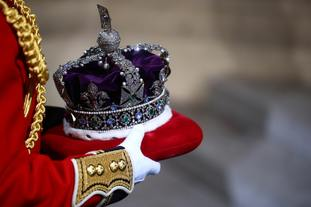 The Imperial State Crown is carried through the Sovereign's Entrance.