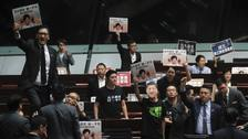 Protests force Hong Kong's Carrie Lam to halt key address