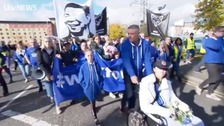 Leicester City fans take part in Vichai remembrance walk
