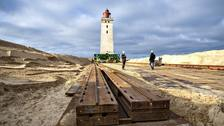 Lighthouse put on wheels in bid to save it from the sea