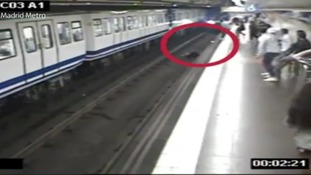 Warning to commuters as passenger distracted by mobile phone falls in front of oncoming train