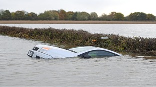 A car submerged in flood water outside Fishlake.