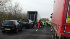 A14 closed: Eight people found in back of lorry