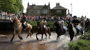Horse riders crossing in West Linton in the Borders during the adult ride-out.
