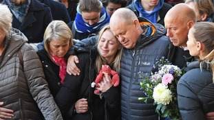 Leanne O'Brien, the girlfriend of Jack Merritt, is comforted by family members during a vigil at The Guildhall in Cambridge.