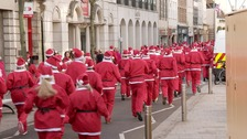 Hundreds of Santas dash through Jersey streets