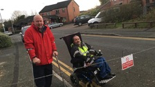 Disabled residents protest parents blocking their road on school run