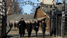 German leader Merkel's 'deep shame' on first visit to Auschwitz