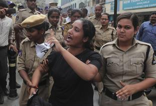 A protestor shouts slogans after being detained by police in Hyderabad