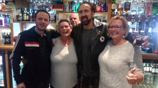 Hollywood star Nicolas Cage spends the New Year at a social club in Wells