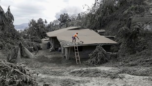 Villages have been destroyed by ash plumes after a dangerous volcano eruption close to Manila.