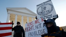 Thousands of gun rights activists take part in rally against new laws