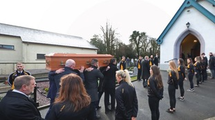 Members of GAA club O'Donnavan Rossa Mullabrack form a guard of honour at the funeral of Seamus Mallon