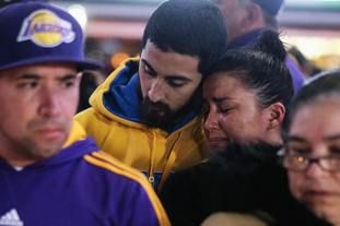 Fans pay their respects at a memorial outside the Staples Centre