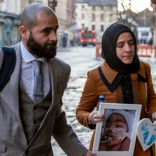 Karwan (left) and Shokhan Ali, the parents of three-month-old Midrar Ali
